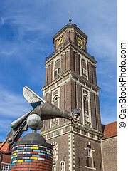 Sculpture and church tower in Coesfeld, Germany