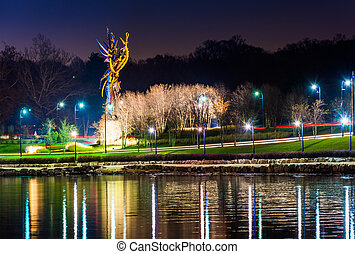 Sculpture and lights along the Potomac River at night, seen from National Harbor, Maryland.