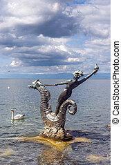 Vevey, Switzerland - September 01: sculpture in the form of a girl with a seashell on the seahorse by Edouard-Marcel Sandoz, Vevey, Lake Geneva, Switzerland on September 01, 2014