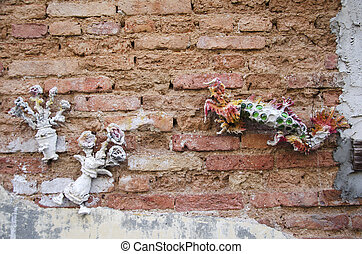 Sculpture dragon and flower from cement on Brick wall Background
