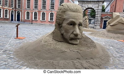 Sculpture of Einstein and the theory of black hole. Exhibition of sand sculptures in the Upper Yard in Dublin Castle.
