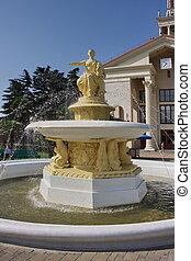 sculpture fountain near the sea terminal in the town of Sochi