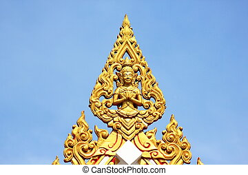 Sculpture in Thailand on a blue background