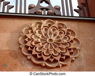 Sculpture of a flower on the wall
