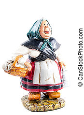 Sculpture of an old farmer woman carrying a basket isolated