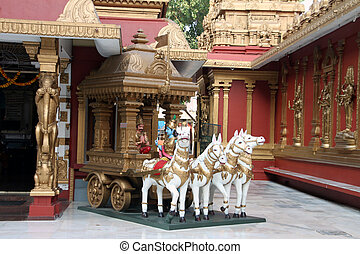 Sculpture of chariot with Lord Krishna and Arjuna, depicting ancient episode from the literature named Mahabharata wherein Lord Krishna tells Bhagwatgita to Arjuna