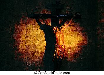 Sculpture of crucified Jesus in a beautiful light