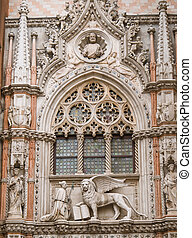 Sculpture of doge and the winged Lion of St. Mark on Doge's Palace in Venice, Italy. Porta della Carta connects the Doge's Palace to St. Mark's Basilica.