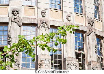 sculpture of Kalevala heroes on wall of old house, Helsinki...