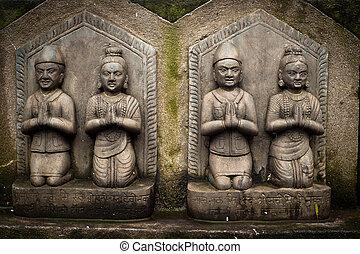 Sculpture of praying peoples. Nepal - Sculpture of praying...