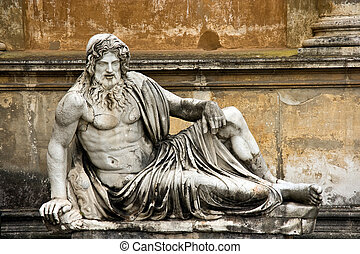 Sculpture of the man semilaying on a bench in a court yard of Vatican.