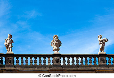 sculpture on blue sky, in the Zwinger palace of Dresden. ...