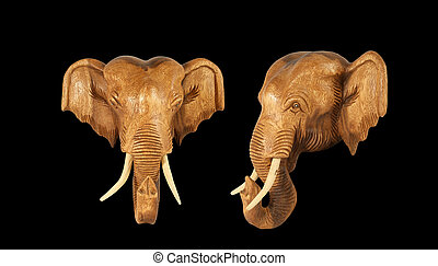 Sculpture (wood) picture elephant head. Isolated on pure black