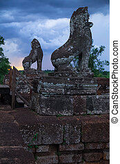 Sculptures of lions on top of Pre Rup temple around Angkor...