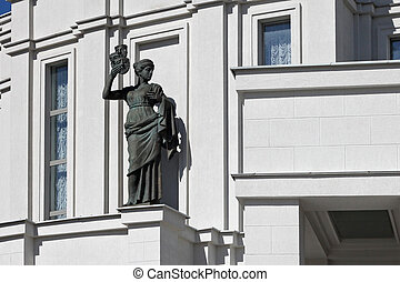 Sculptures of The National Academic Grand Opera and Ballet Theatre of the Republic of Belarus. The building was built in 1938 by architect J. Langbard. It is an example of soviet constructivism.