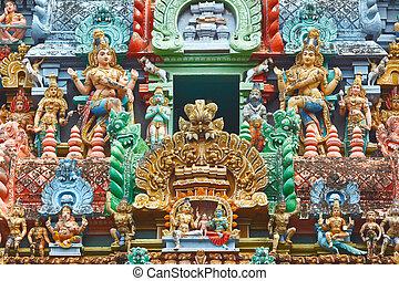 Sculptures on Hindu temple gopura (tower). Jambukeshwarar...