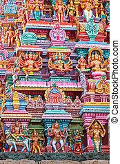 Sculptures on Hindu temple gopura (tower). Menakshi Temple, ...