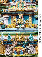 Sculptures on Hindu temple gopura (tower). Sri...