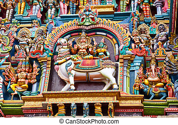 Sculptures on Hindu temple tower - Shiva and Parvati on bull...