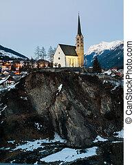 Scuol church in winter time evening (Switzerland)