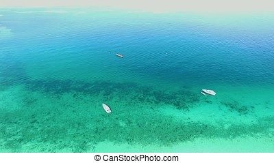 Sea Aerial view, Top view,amazing nature background.The color of the water and beautifully bright.Azure beach with rocky mountains and clear water of Thailand ocean at sunny day. Tropical beach