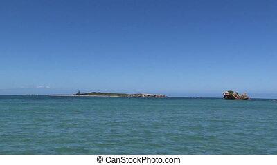 Sea and an island shot - A full shot of sea and an island