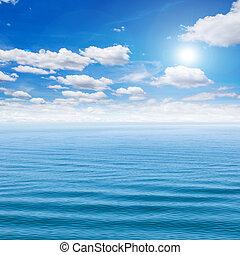 Sea and blue sky with sun