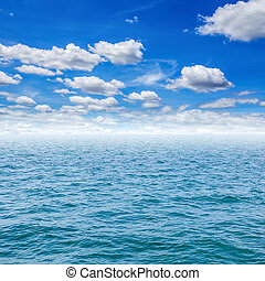 Sea and clouds with blue sky