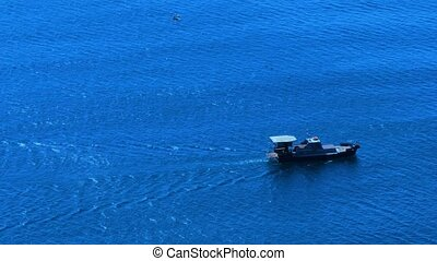 Sea and motor boat - Lonely motor boat in the sea. The boat...