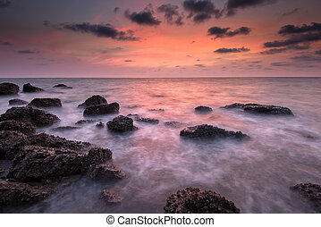 Sea and rock at the sunset Nature