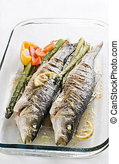 Sea bass - Baked sea bass with vegetables close up shoot