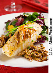Sea bass with mushrooms and salad