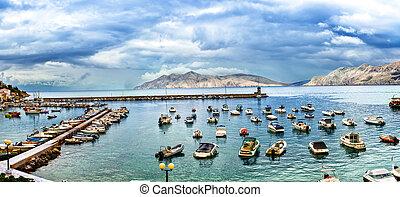 Sea bay docks with yachts, small boats and motorboats. Vacation boats harbor with beautiful coastline skyline