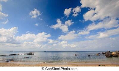 Sea Bay with Wooden Pier Rocks Waves Splash against Sky