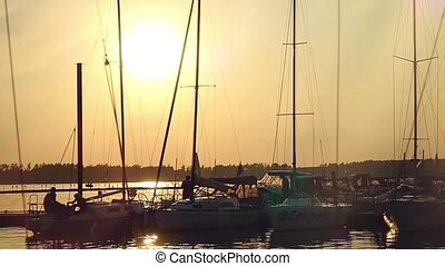 Sea bay with yachts at sunset at a wharf. Slowmotion....
