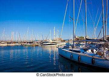 Sea bay with yachts.  Fishing boats in the harbour