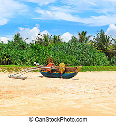 Sea beach and an old boat on the sand