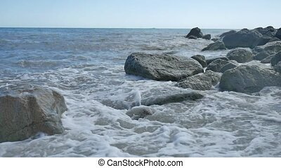 Sea beach storm mountains stones strong nature waves water the landscape slow motion video