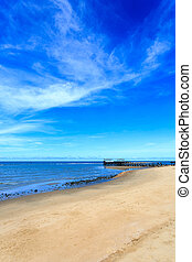 Sea beach with blue sky