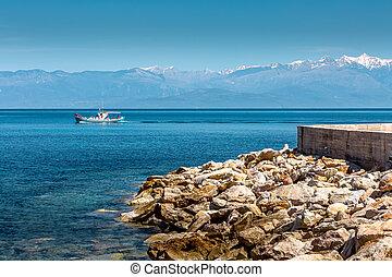 Sea, boat, snow mountains, Peloponnese, Greece - Blue sea ...