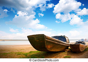 Wooden boat along the coast, archaic.