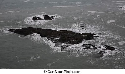 Sea breaking over rocks in Cornwall