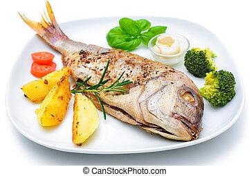 Sea bream fish with potato on white plate
