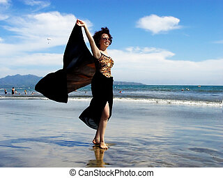 Sea breeze - Beautiful woman with a scarf standing on the ...