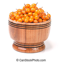 Sea-buckthorn berries in a wooden bowl isolated on white background
