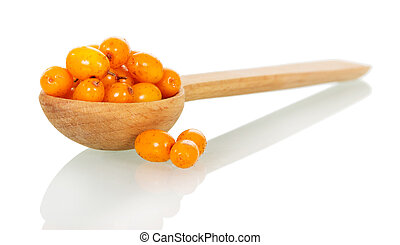 Sea-buckthorn berries in wooden spoon isolated on white background.
