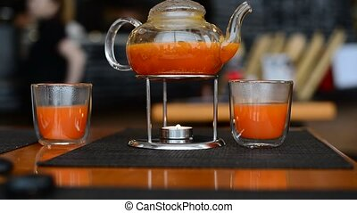 Sea Buckthorn tea candle basking in Japanese restaurant -...