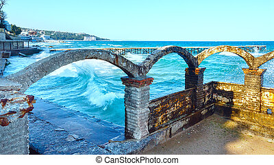 Sea storm, ruined pier and splashes of surf in front (Black Sea, Bulgaria, near Varna).
