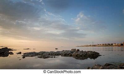Sea coast at sunset. Time lapse