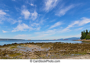 Sea coast during low tide near Stanley Park in Vancouver, Canada.
